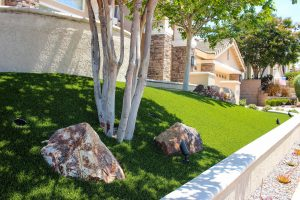 artificial turf installed in San Diego one-story home front yard near sidewalk