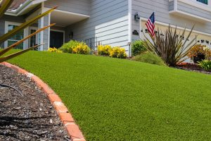 artificial turf installed in San Diego home yard near garage