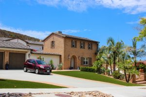 artificial turf installed in San Diego home front yard luxury residence with driveway