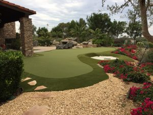 Putting green in Socal backyard with sand trap